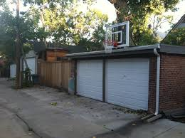 a roof king gold basketball system sits above this denver alleyway