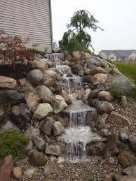 Lawn  Garden  Small Natural Stone Backyard Waterfall Design - Backyard waterfall design