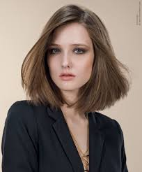 sleek shoulder length bob hairstyle with simple lines