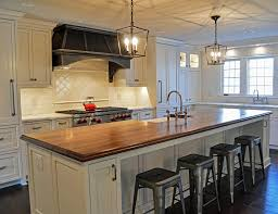 wood island kitchen distressed walnut countertop designed by studio 76 kitchens