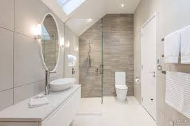 white bathroom with angular ceiling and timber look tiles