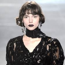 mismatched earrings trend the jewelry trends you ll see everywhere this season
