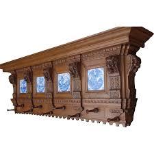 large antique carved wood coat rack lion head tiles biblical