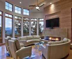 circular room living contemporary with tv over fireplace leather