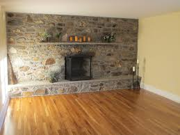 great brown wooden floors installations with grey wall stones