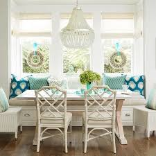 white wicker kitchen table ivory and turquoise blue dining room features a built in banquette