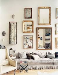 Sofa Table Against Wall Grey Sofa With Ruffles Against Wall Mirrors And Decor In The