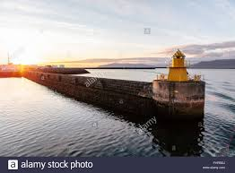 Sunset Reykjavik A Yellow Lighthouse In Reykjavik Harbour Iceland At Sunset Stock