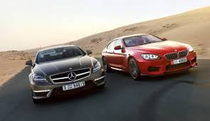 bmw vs mercedes mercedes cls vs bmw 6 series which 4 door luxury coupe is