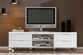 tv in middle of room white wooden tv stand with two shelves on the middle of drawers