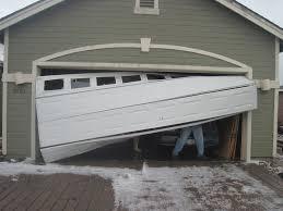 Overhead Garage Door Problems 7 Ways To Fix A Dent In A Garage Door Panel
