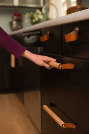 railroad spike cabinet pulls pull off a new look for your kitchen or bath with updated cabinet