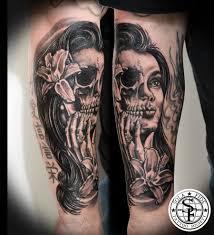 Forearm Skull - half half skull black and gray forearm sola fidé