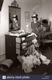 1940s shocked woman discovers ransacked bureau in bedroom