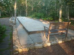 bocce court for a mediterranean landscape with a oakpit bbq and