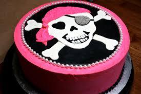 pink skull crossbones cake