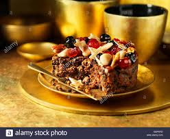 fruit and nuts decorating traditional fruit cake stock