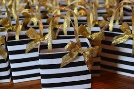 gold favor bags black and white stripe party favor bag with gold bow and handles