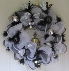 silver black and white balls don this wreath and adds a