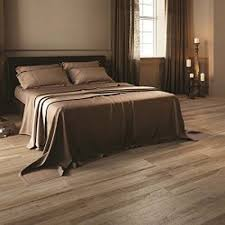 This Modern Bedroom Features Silk Silver Marble Effect by 10 Best Wood Effect Wall And Floor Tiles Images On Pinterest