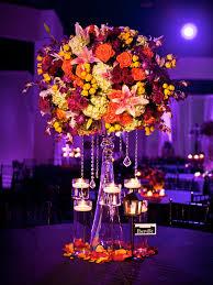 contrasting tall fall wedding centerpiece with lightingwedwebtalks