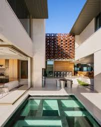 Home Architecture Design Modern A Stunning L Shaped Pool Melds The Exterior With The Interior Of