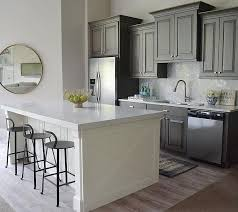 white and gray painted kitchen cabinets pair gray cabinets with warm colors and materials gray can