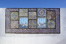ornamental windows on roof top terrace in tunisia stock photo