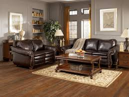 classy living room interior with dark brown leather sofa set with