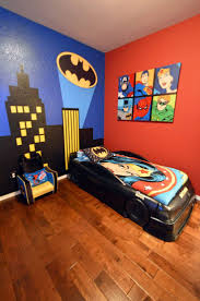 my batman gotham city wall mural home is where the heart is boy s batman superhero themed room with bat signal over the city wall mural batmobile bed