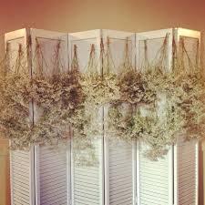 Wedding Backdrop Themes Babys Breathe And Hemp Used To Create A Wedding Backdrop
