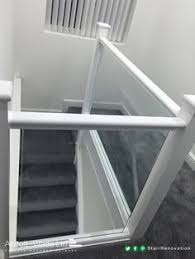 Glass Banisters Carpeted White Staircase With Clamped Glass Balustrade Jdub 88