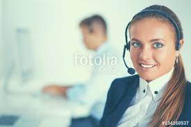 Sitting On The Desk Happy Female Wearing Headset And Sitting On The Desk