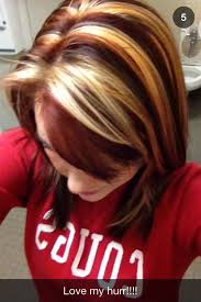 blonde hair with chunky highlights dark brown hair with chunky blonde and red highlights