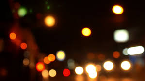 blurred defocused lights of heavy traffic on a city road at