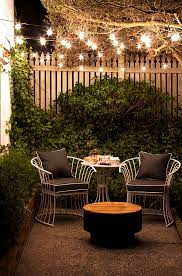 Stringing Lights In Backyard by Small Patio Decorating Ideas For Renters And Everyone Else