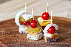 canapé made in canape with salted lard bread cherry tomato pickled cucumber