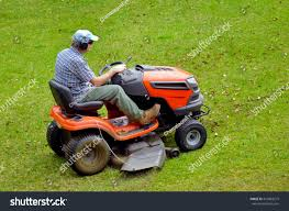 gardner on rideon lawn mower cutting stock photo 216863215