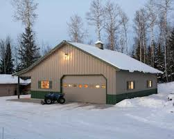 pole barn garage with mancave in the back double garage doors