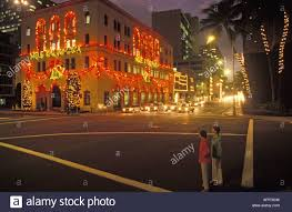 christmas lights at night in downtown honolulu stock photo