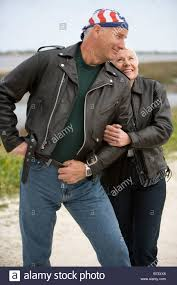 cool biker jackets happy senior couple in leather biker jackets standing together