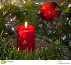 christmas candle with a wreath and red ornament royalty free stock