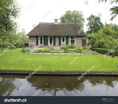 Giethoorn Holland Homes For Sale by Traditional Thatched House Touristic Village Giethoorn Stock Photo