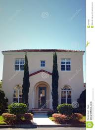 spanish style home with tall trees at entrance stock image image