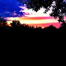 American Flag Sunset The Sky Cloud And Angle Of The Sun Makes It Look Like The