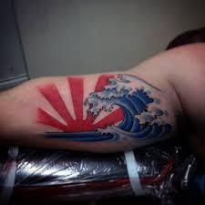 bicep with japanese rising sun tattoos