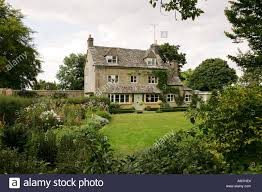 family home and garden typical limestone built cotswold house cottage family home with