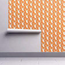 stag deer head pattern on orange wallpaper by inspirationz
