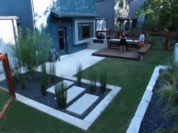 wonderful modern backyard idea with compact grasses and small wood