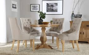 round oak kitchen table cavendish round oak dining table and 4 fabric chairs set duke